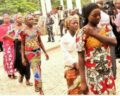 Chibok girls who managed to escape arriving at Nigeria's State House to meet with Nigerian President Jonathan.  Abuja, Nigeria; July 22, 2014 Reuben Abati, Presidential Spokesman, Nigeria