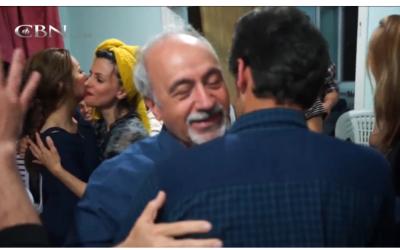 Joyous Iranian house church, (PHOTO: CBN screenshot)