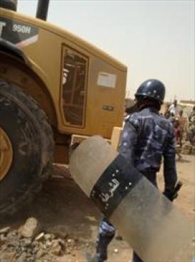 Sudanese authorities demolishing the Church of Christ in Thiba.