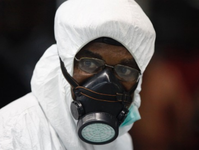 A Nigerian health official wears protective gear August 6 at the Murtala Muhammed International Airport in Lagos, Nigeria. (PHOTO: CNN)
