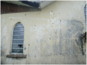 Bullet holes in Zion Praise Baptist Church, serving as a chilling reminder of the horrible civil war that massacred this precious nation.