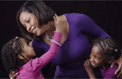 Genelle Guzman-McMillan with her daughters.