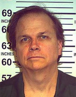 Mark David Chapman posing for a mugshot in 2013. (PHOTO: New York State Department of Corrections)