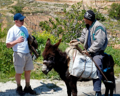 David encounters a peasant Arab man on a Donkey whilst carrying his cross and bowl through Judea.