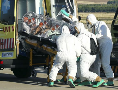 Health workers load Ebola patient, Spanish priest Miguel Pajares, into an ambulance on the tarmac of Torrejon airbase in Madrid, after he was repatriated from Liberia for treatment in Spain, August 7, 2014. (PHOTO: REUTERS/MINISTRY OF DEFENCE/HANDOUT VIA REUTERS)