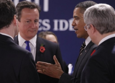 US President Barack Obama talks with British Prime Minister David Cameron during a working session at the G20 Summit in Cannes (PHOTO: AP)