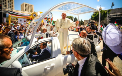 Pope Francis waving to the people after a mass in the Manger Square, next the Nativity Church, in the West Bank city of Bethlehem on May 25, 2014 (photo credit: Atta Jaber/Flash90).