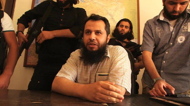 Hassan Abboud (seated) and members of the Islamic Front Hassan Abboud (seated) was the head of the political bureau of the Islamic Front alliance.