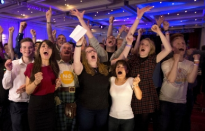 Supporters for the Scottish independence referendum celebrate a result at a No campaign event at a hotel in Glasgow, Scotland, early Friday, Sept. 19, 2014.