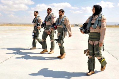 A picture dated June 18 and made available by UAE's official news agency WAM on Sept. 25 shows Maj. Mariam al-Mansouri, the first female pilot to join the Emirates Air Forces, walking alongside her comrades at an air force base. (HO/WAM via AFP)