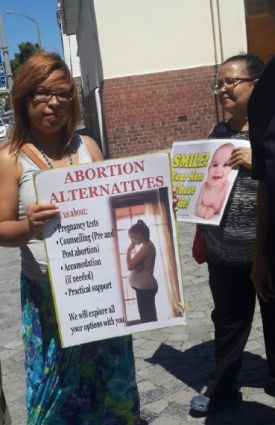 The vigil participants use posters to create awareness about the consequences of abortion and various alernatives to abortion that are available. (PHOTO: Mieta Sishuba).