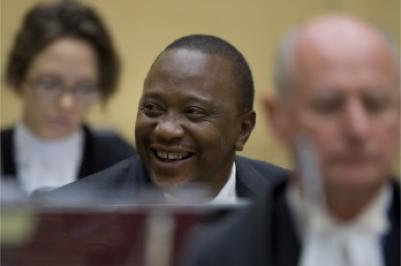 Kenyan President Uhuru Kenyatta, center, sits amidst his defense team members before the International Criminal Court in The Hague. (PHOTO: Associated Press/Photo by Peter Dejong, Pool)