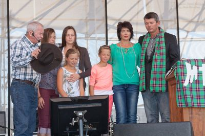 Angus Buchan prays for KMMC coordinator Jannie Moolman (right) and his wife Marelize and daughters.