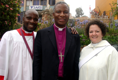 Archbishop Thabo Makgoba (centre) with Tonde James Nhererwa and The Revd Claire Phelps who were his chaplains during a Thanksgiving service