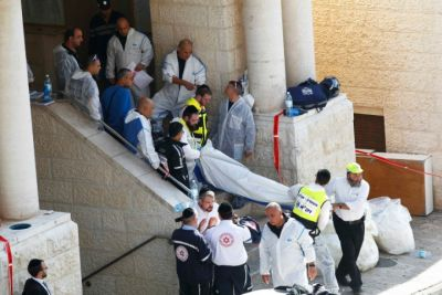 The body of a victim is carried from the scene at a West Jerusalem synagogue on November 18, 2014. (PHOTO: Reuters).