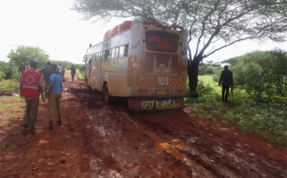 Rescue workers walk near a Nairobi-bound bus that was ambushed outside Mandera town, near Kenya's border with Somalia and Ethiopia, November 22, 2014. Somalia's al Shabaab insurgents said they were behind the bus attack in northeast Kenya that killed 28 people on Saturday, saying it was in retaliation for raids on mosques in the port city of Mombasa. Three of the group led out to be killed saved their lives by reciting verses of the Koran for the militants, a local security official said. (PHOTO: Reuters).