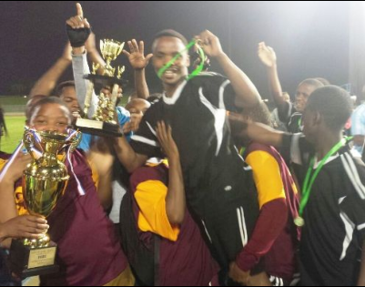 The Sakhuluntu Soccer Team receiving the trophy for being champions of the KoG Sport Touranament.