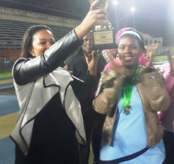 Ps Asanda Nojoko (mother of FABC) honouring the netball captain from Sakhuluntu for being the champions of the Tournament.