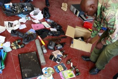 Reuters Hand grenades and other items displayed by police after a raid of the Mombasa mosque yesterday. (PHOTO: rEUTERS