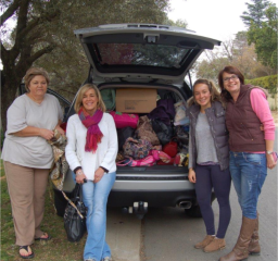 Lee, Karen, Ash and Niki with a carload of bags ready for delivery to a shelter.