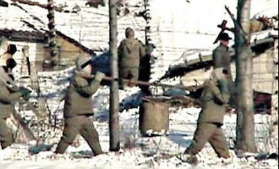 Brutal: Life in the totalitarian North Korean camps has been laid bare by a former guard (not pictured) Read more: http://www.dailymail.co.uk/news/article-2565988/Inside-North-Koreas-secret-gulags-Prisoners-strangled-death-hungry-ate-GRASS-200-square-mile-complex-20-000-inmates.html#ixzz3LfbKbROp  Follow us: @MailOnline on Twitter | DailyMail on Facebook