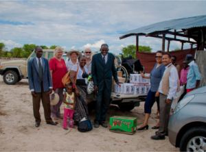 A second wheelchair as well as food and other gifts were handed over to Pastor Vincent at a church in Akweira. Mission trip members are Barbara Bresler (second from left) and Louise and Peter Dawson (to the right of Barbara).