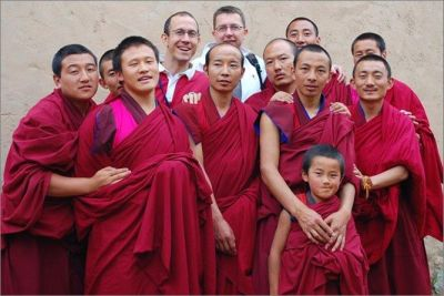 Making friends with Bhuddist monks in a village.
