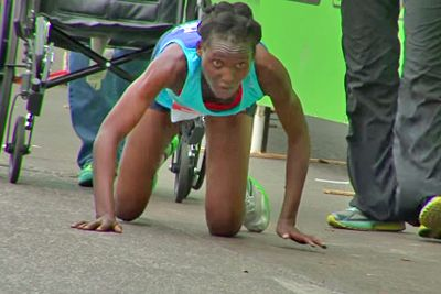 Hyvon Ngetich -- crawling to honour in the recent Austin marathon.