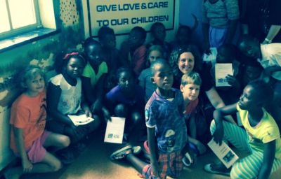 Powerclub children praying for babies at Frere Hospital, East London. Children's Church Pastor Esme Schmitt is kneeling with the children.