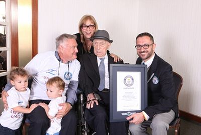 Marco Frigatti, Head of Records for Guinness World Records, presents Israel Kristal his certificate of achievement for Oldest living man on 11th March 2016, Haifa, Israel. Picture credit: Dvir Rosen/Guinness World Records From L-R: grandchildren Nevo and Omer, Heim Kristal (son), Shula Kuperstoch (daughter), Israel Kristal, Marco Frigatti