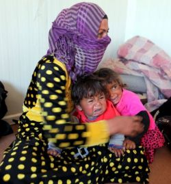 weeping-children-with-their-mother-who-fled-with-them-from-islamic-state-strongholds-of-hawija-and-shirqat-to-seek-refuge-in-a-refugee-centre-in-makhmour-south-of-mosul-iraq