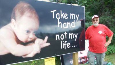 Pro-life billboards at Catholic cemetery in Canda vandalised but caretakers choose not to be angry