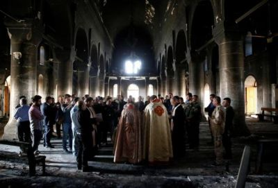 Iraqi Christians worship amid church ruins for first time since liberation