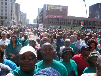 PE church leader speaks up for poor at city hall protest rally