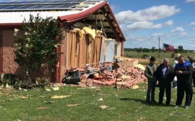 Tornado shreds church, spares 45 praying in the hallway