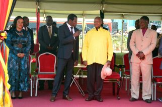 Pastor Robert Kayanja (second from left) of the Miracle Centre Cathedral chats with President Yoweri Museveni of Uganda (third from left) at a pastors' meeting with the President held in Kampala recently. The meeting was called by President Museveni to discuss the proposed National Policy on Religious and Faith-Based Organizations (R&FBOs) that requires pastors to have former training and a certificate before starting a church. The pastors are against the policy. Photo by John Semakula.