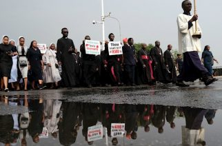 Image: Kola Sulaimon / AFP via Getty Images Nigerian Catholics march in Abuja on March 1 in protest of recent terrorist attacks.